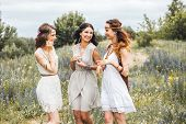 Three Beautiful Cheerful Hippie Girls, Best Friends, Outdoors, Laughing, Having Fun, Stylish Hairsty poster