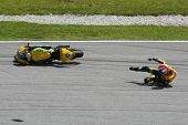 SEPANG, MALAYSIA - OCTOBER 21: Moto2 rider Mattia Pasini falls at turn 15 during free practice at th