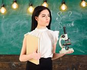Lady Scientist Holds Book And Microscope, Chalkboard On Background, Copy Space. Lady In Formal Wear  poster