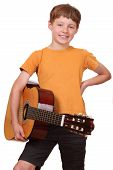 foto of musical instrument string  - Portrait of a young boy holding a classical guitar - JPG