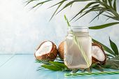 Coconut Water And Coconuts On A Bright Pastel Background. poster