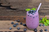 Blueberry Smoothies Juice A Tasty Healthy Drink In A Glass Drink The Morning On A Wooden Background. poster