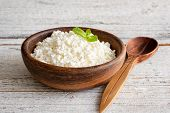 Ricotta Cheese, Curd Cheese, Farmers Cheese Or Tvorog In Wooden Bowl. Selective Focus. Concept Of He poster