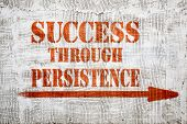 success through persistence - graffiti sign with arrow on stucco wall poster
