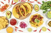 An Overhead Photo Of An Assortment Of Many Different Mexican Foods, Including Tacos, Guacamole, Pico poster