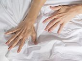 Hand Clutches Grasps A White Crumpled Bed Sheet In A Hotel Room, A Sign Of Ecstasy, Feeling Of Pleas poster