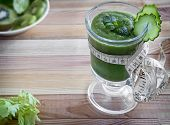 On The Table In A Glass Vessel Low-calorie Smoothie Made Of Cucumber, Celery, Apples And Kiwi, Desig poster