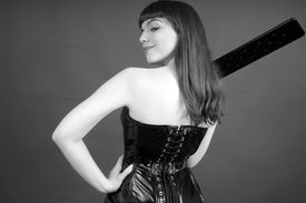 picture of domina  - attractive domina getting reading to punish her slaves - JPG