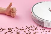 White Robot Vacuum Cleaner On A Pink Background With Coffee Grains. Concept Of Cleaning With A Robot poster
