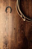 Old Horseshoe And Lariat Lasso On Wood Barn Wall
