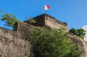 French Flag On A Top Of Fort Saint Louis In Fort-de-france, Martinique poster