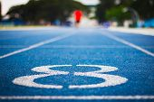 Number Eight On The Start Of A Running Track .blue Treadmill With Different Numbers And White Lines. poster