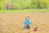 Mother Nature Concept. Child Having Fun With Little Shovel And Plant In Pot. Planting Seedlings. Pla poster