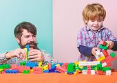 Child Care Development And Upbringing. Father Son Game. Father And Son Create Colorful Constructions poster