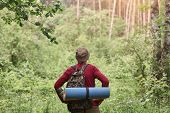 Hiking. Man Wearing Red Sweater And Cap In Hike, Having Backpack And Sleeping Pad, Looking Towards.  poster