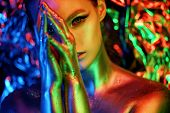 High Fashion Model Girl Portrait With Colorful Powder Make Up. Beauty Woman With Bright Color Makeup poster