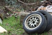 Dumped Car Tyres. Fly-tipping Old Tyre Waste And Rubber Recycling. Two Vehicle Tires Discarded Illeg poster