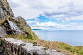 The Cliff Walk Bray To Greystones With Beautiful Coastline, Cliffs, Boulder Stone Wall And Turquoise poster