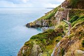 Train Exiting A Tunnel. View From Cliff Walk Bray To Greystones With Beautiful Coastline, Cliffs And poster
