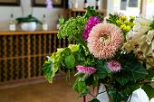 Colorful Natural Flowers On Vase Selective Focus Closeup View, Winery Tasting Room Wines Shop Interi poster