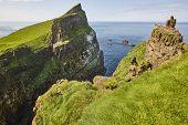Faroe Islands Green Cliffs In Mykines Island. Atlantic Ocean Coastline poster
