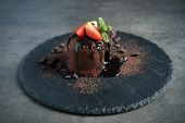 Delicious Warm Chocolate Lava Cake On Grey Table poster