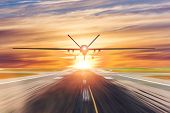 Military Unmanned Aerial Vehicle Takes Off From Runway At A Military Base In The Evening At Sunset poster