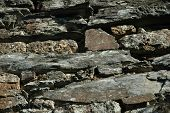 foto of fieldstone-wall  - A detail of the stone wall of the ancient English house - JPG
