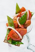 foto of snow peas  - Crisp bread with tomatoes and snow peas selective focus - JPG