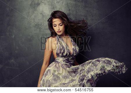 beautiful young  woman in an elegant dress studio shot poster