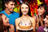 picture of congrats  - Portrait of joyful girl with birthday cake surrounded by friends at party - JPG