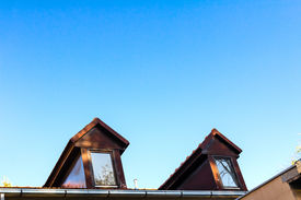 image of gabled dormer window  - Dormer windows and rooftop of old home - JPG