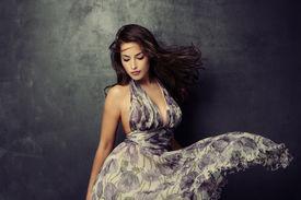 pic of flutter  - beautiful young  woman in an elegant dress studio shot - JPG