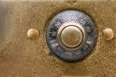 stock photo of combination lock  - Antique dial combination lock close up - JPG