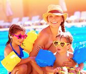 stock photo of swimming pool family  - Happy family in summer vacation - JPG