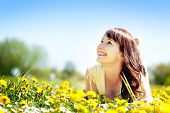 picture of harmony  - Young beautiful woman lying on grass full of spring flowers - JPG