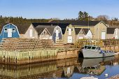 foto of lobster boat  - Lobster traps stacked on the wharf in rural Prince Edward Island - JPG