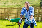 picture of grass-cutter  - happy man mowing lawn at home garden - JPG