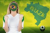 image of football pitch  - Excited brasil fan in face paint cheering against football pitch with brazil outline and text - JPG