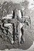 stock photo of ashes  - Christian cross made by grey wood ash - JPG