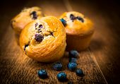 stock photo of home-made bread  - home made blueberry Muffins On Wooden Table - JPG