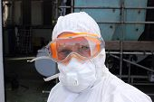 image of ppe  - an industrial employee in full personal protection equipment - JPG