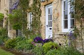 picture of english cottage garden  - Pretty Cotswold cottage with spring - JPG