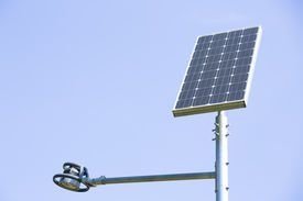 stock photo of solar battery  - solar battery powers an electric lamp in the park - JPG
