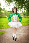 pic of cross-dress  - Young woman in irish dance dress and wig posing outdoor - JPG