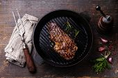 picture of ribeye steak  - Grilled Ribeye steak entrecote on grill pan on wooden background - JPG