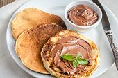 picture of sugar paste  - Pancakes With Chocolate Cream On The Wooden Table - JPG