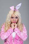 foto of bunny costume  - Beautiful young blond woman as easter bunny with rabbit ears on  - JPG