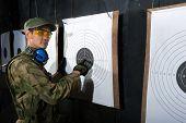 picture of shooting-range  - Man with target in shooting range in glases - JPG