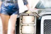 image of police  - Women dressed like police officer leans her elbow on old rare and stylish model of police car - JPG